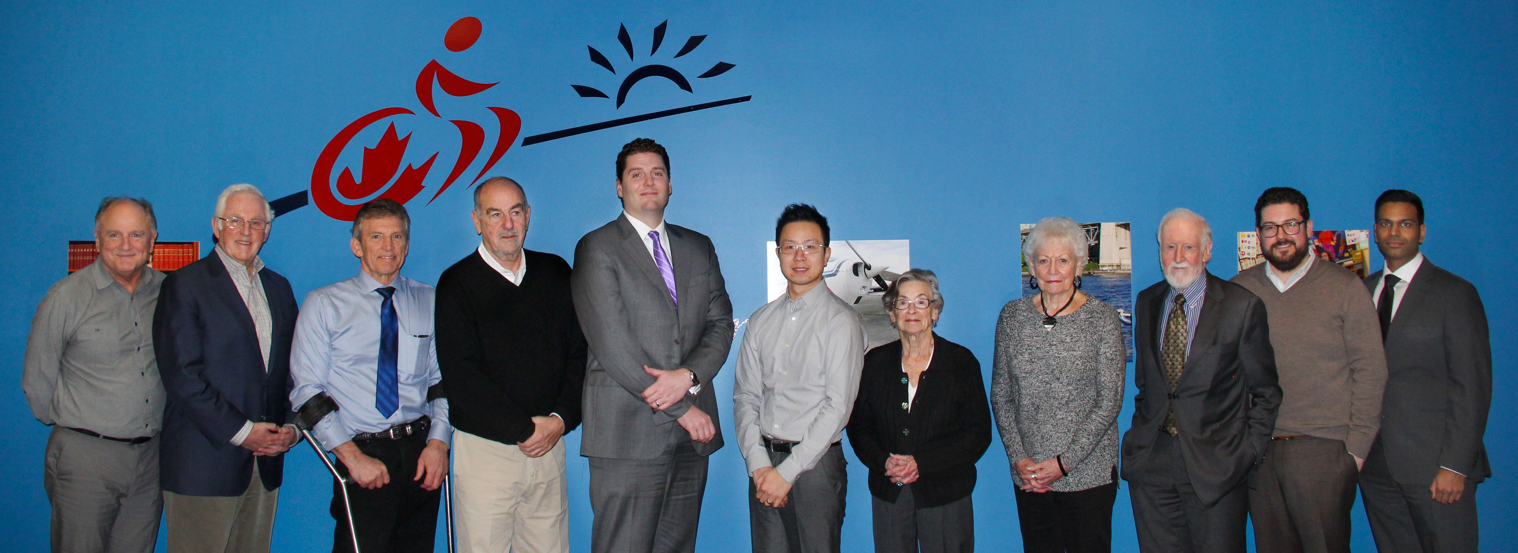 a group of people who are on the BCPF board posing at the head office for SCI BC