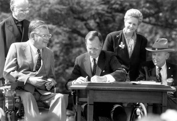 George Bush signs the Americans with Disabilities Act of 1990.
