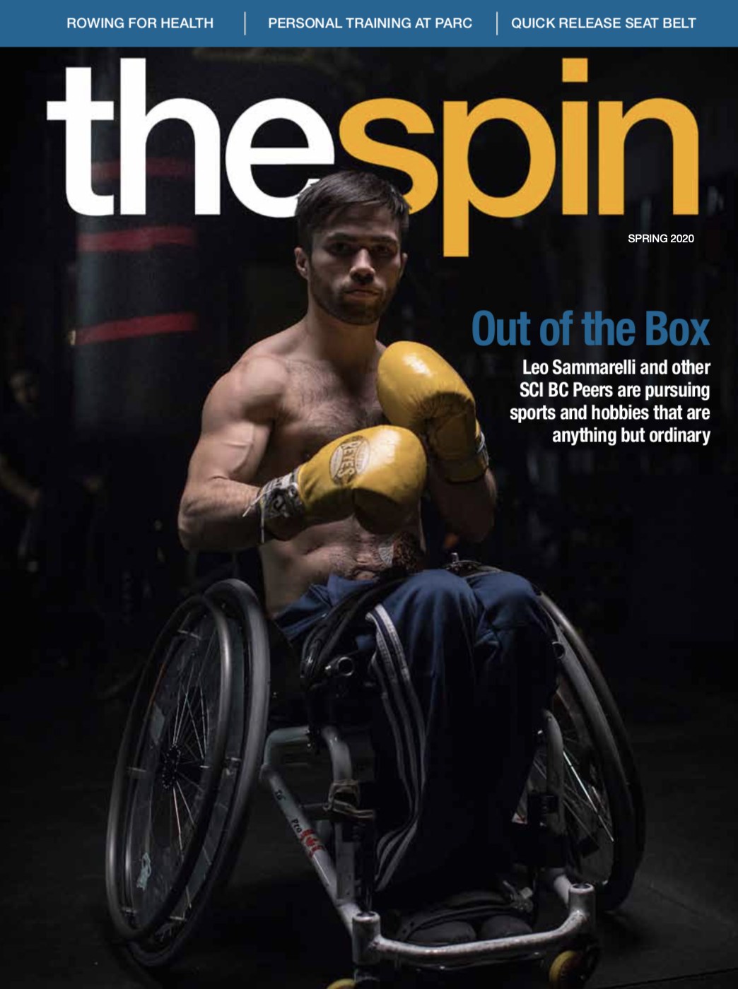 photo of a man in a wheelchair with boxing gloves on. This is the cover of The Spin spring 2020 magazine.
