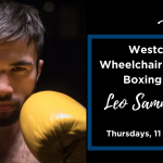 Close up on Leo Sammarelli looking into camera holding up yellow boxing gloves