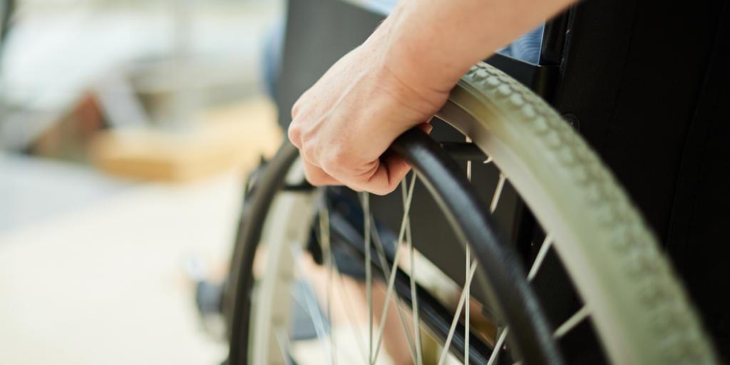 person wheeling their wheelchair