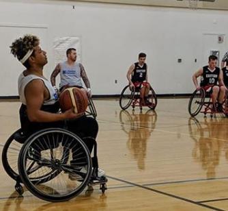 a man plays wheelchair basketball