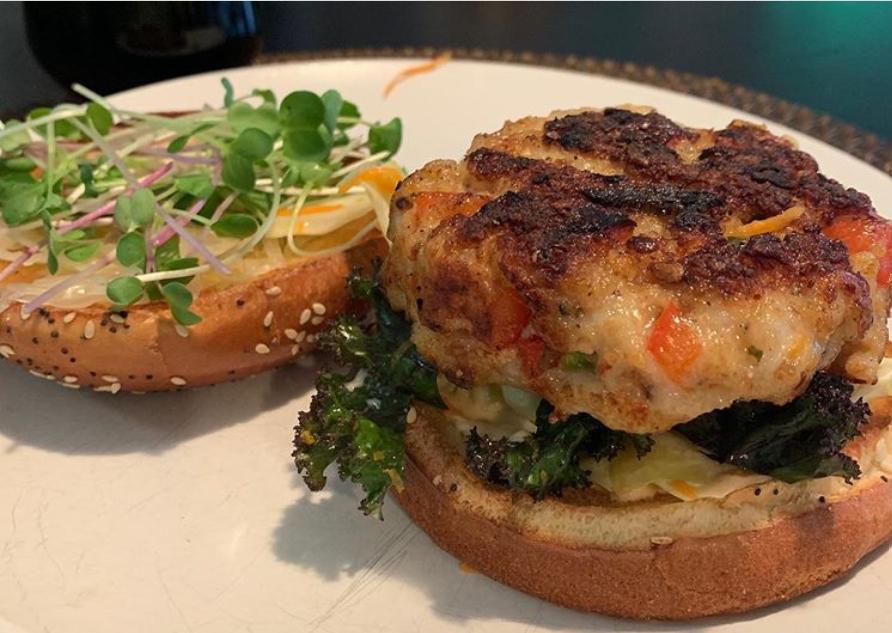 a partially assembled prawn burger