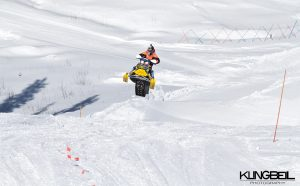 Darryl Tait speeds down a run on his snowmobile
