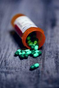a prescription pill bottle spilled on a counter