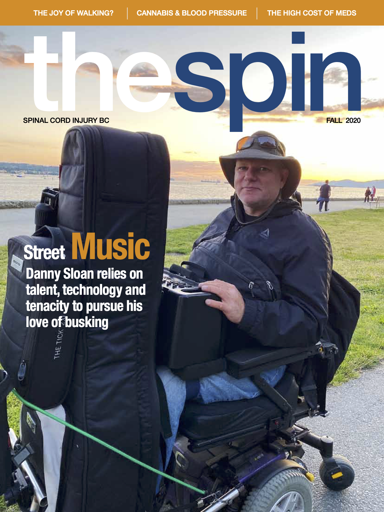The Spin Winter 2020 cover photo featuring a busking musician in a wheelchair with a guitar rack and a speaker on his lap