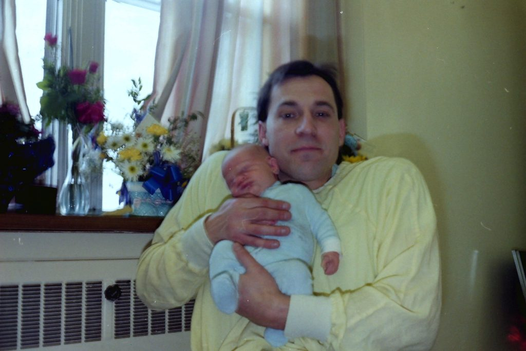 photo of Pat Harris holding his baby