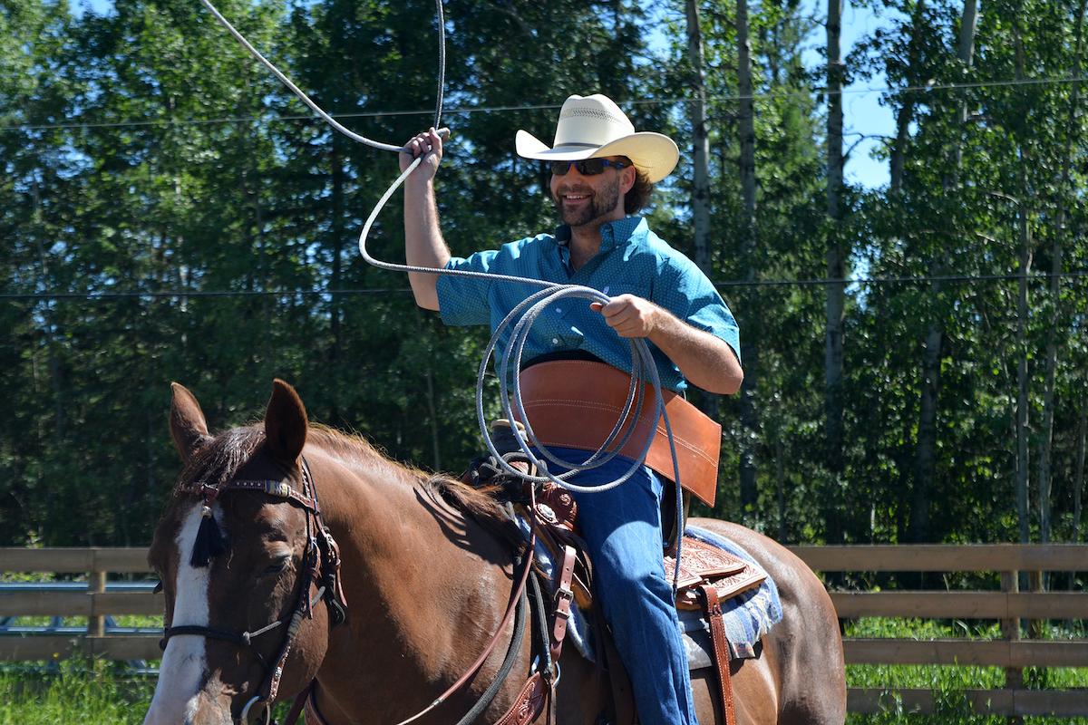 A man rides a horse using an adaptive saddle