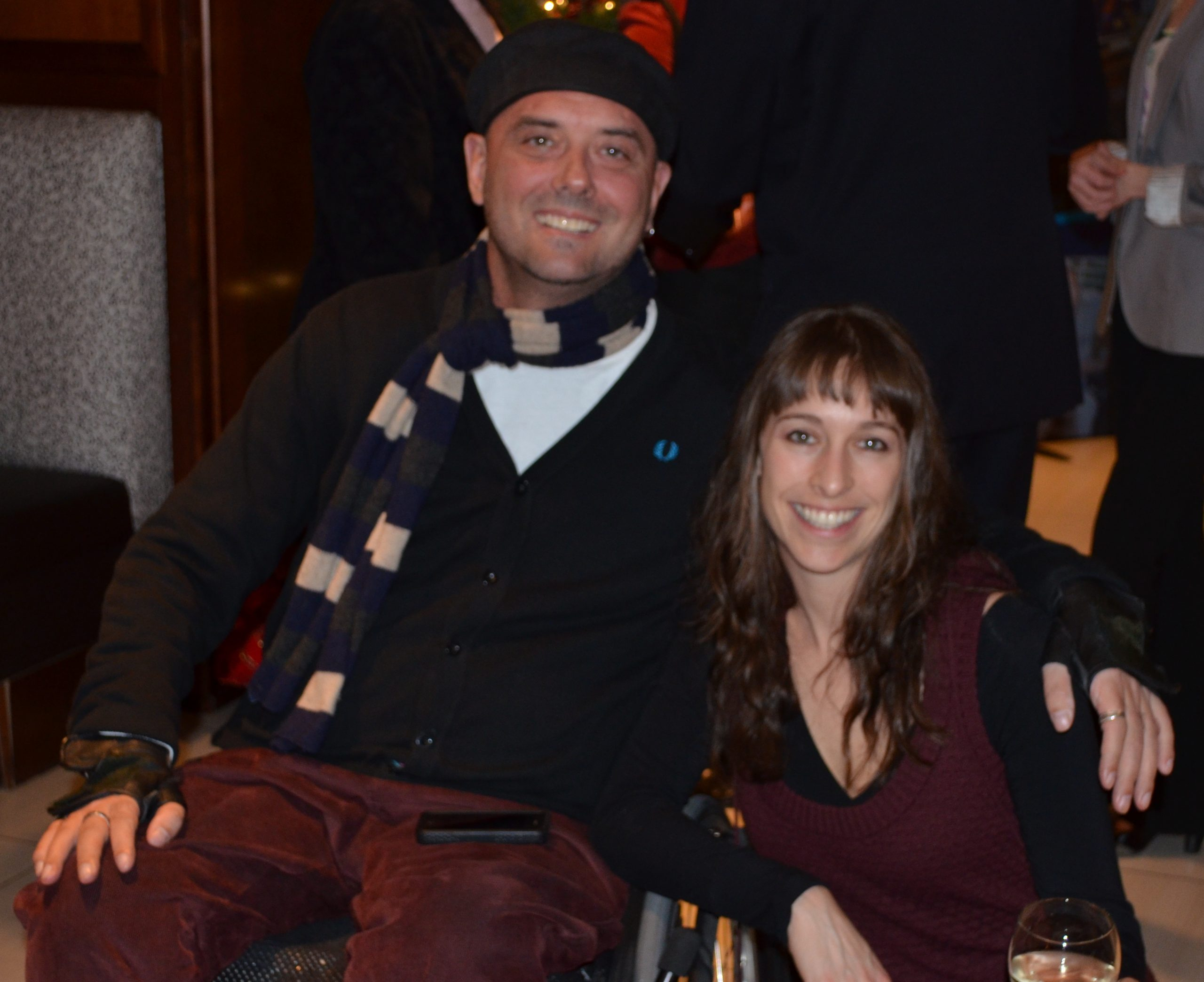 Brad in cap and striped scarf at holiday party pictured with Shelley Milstein