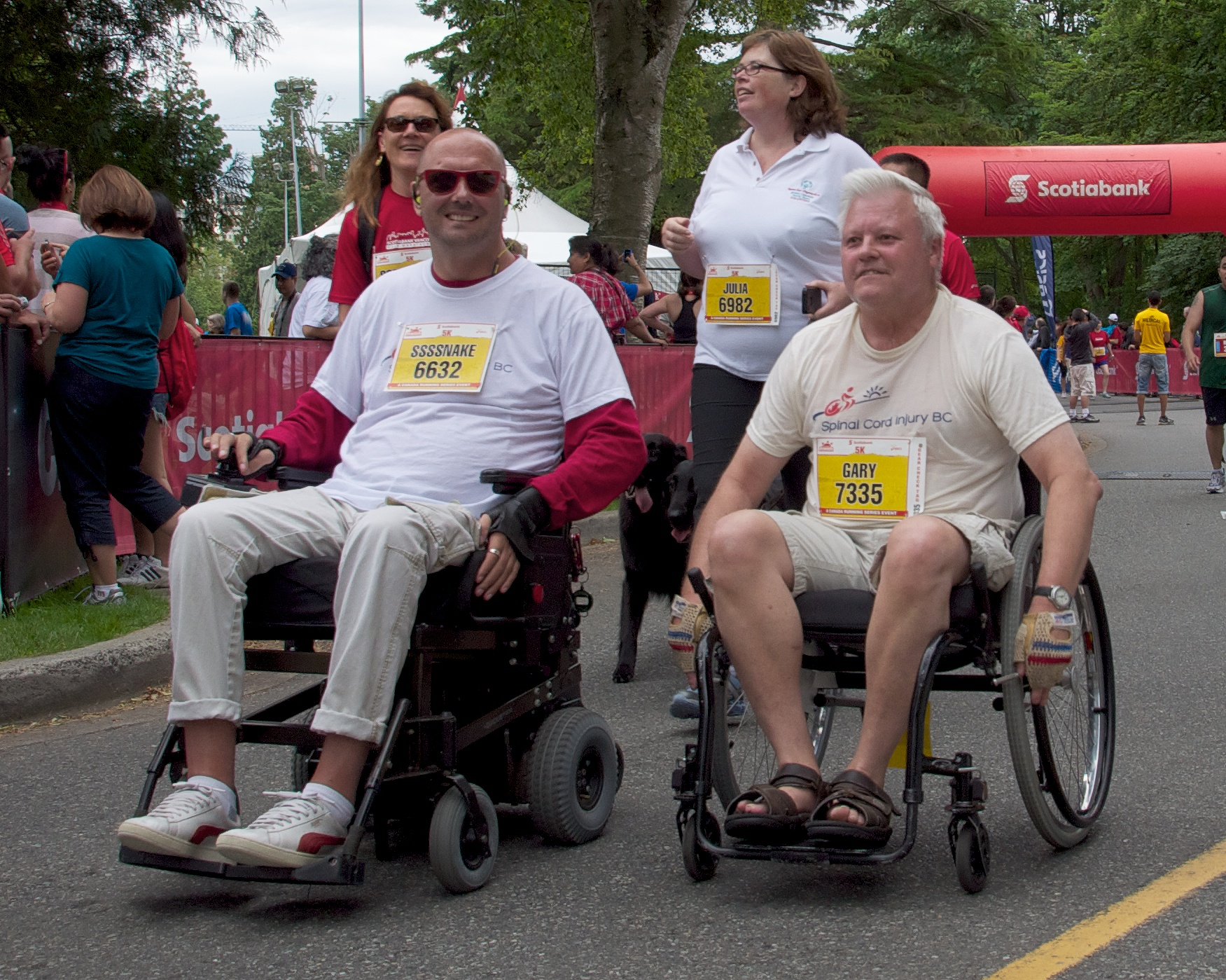 Brad racing beside a friend in the Scotiabank Charity Run