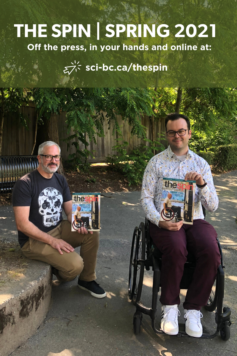 two men hold up The Spin Summer 2021 issue. One of them is in a wheelchair and the other sits nearby on a bench. There is a beautiful park behind them.