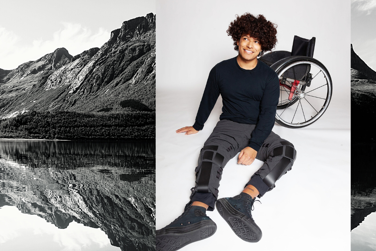 Paulo Guerrero is pictured sitting on the ground, in front of his wheelchair, wearing the Resilience climbing pants.
