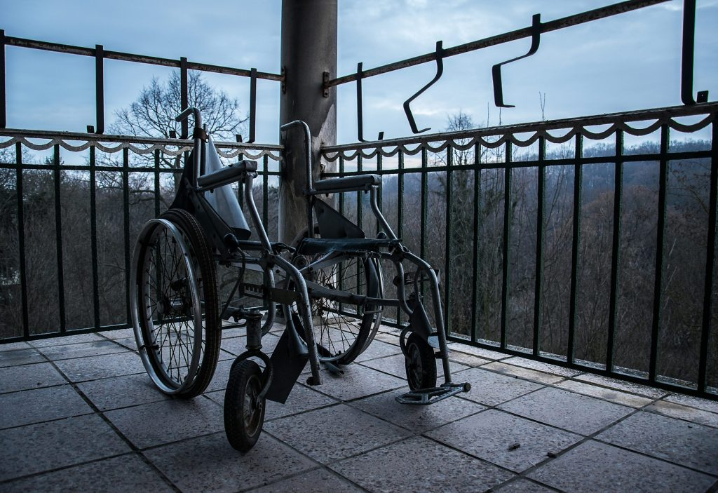 a broken wheelchair on a patio