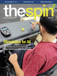 cover photo of The Spin Fall 2021 issue featuring a man with quadriplegia using an external neurostimulation device